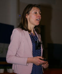 Photo of Annemie Bogaerts presenting a plenary lecture on ICP-MS modeling